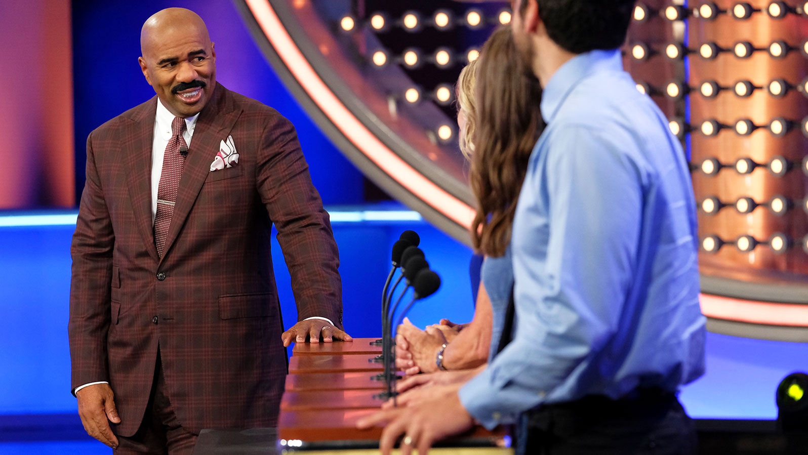 Steve Harvey laughing on the set of Family Feud